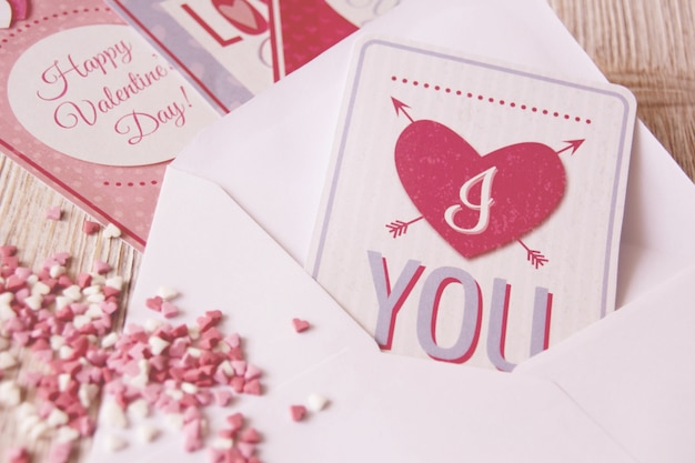 Letter with a postcard with a heart and heart-shaped candies