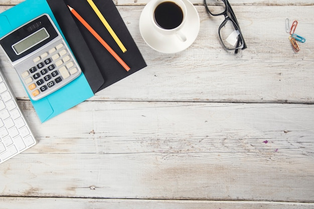Letter with stationary and coffee with keyboard on desk
