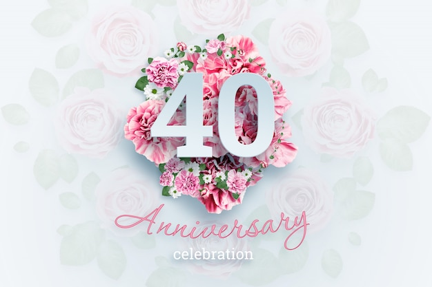 Lettering 40 numbers and anniversary celebration text on pink flowers.