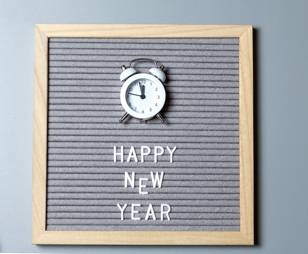 Lettering on chalkboard happy new year