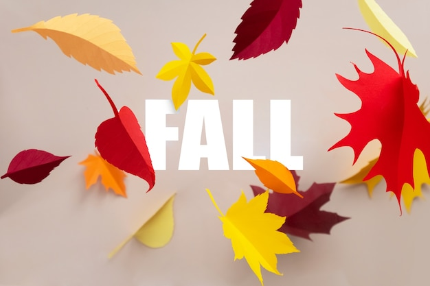 Lettering fall cut from paper with paper autumn leaves