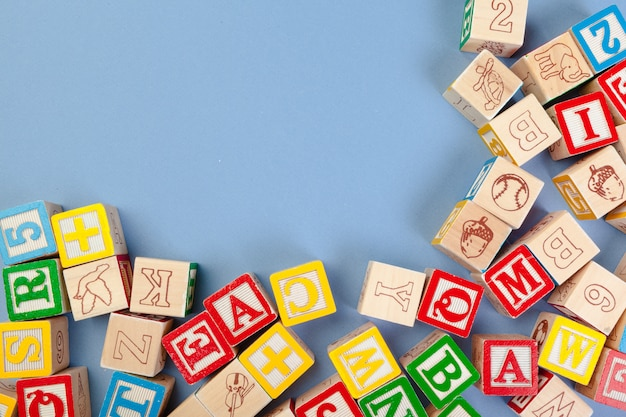 Letters background. wooden cubes with letters with copy space