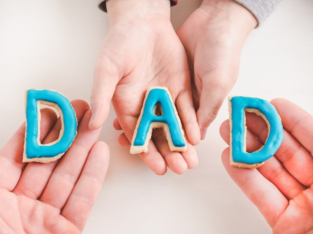 Letters in the form of the word dad