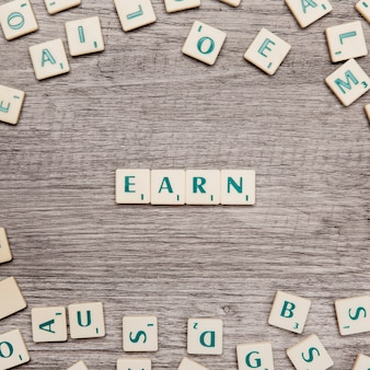 Letters forming the word earn