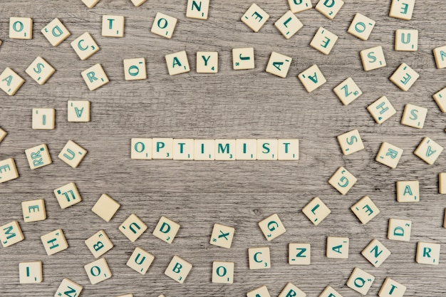 Letters forming the word optimist