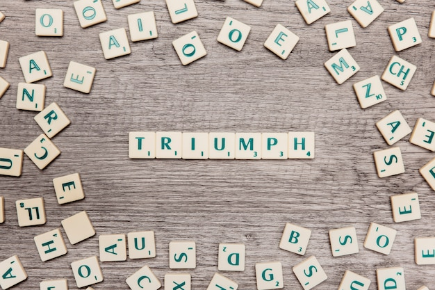 Letters forming the word triumph