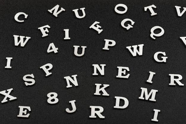 Letters of latin alphabet on black background.