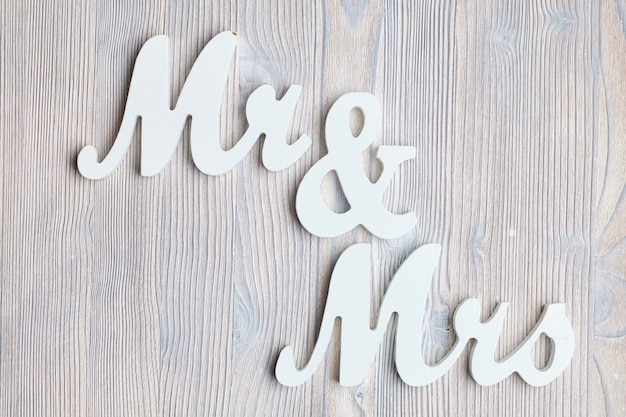 Letters mr and mrs on a wooden background. top view.