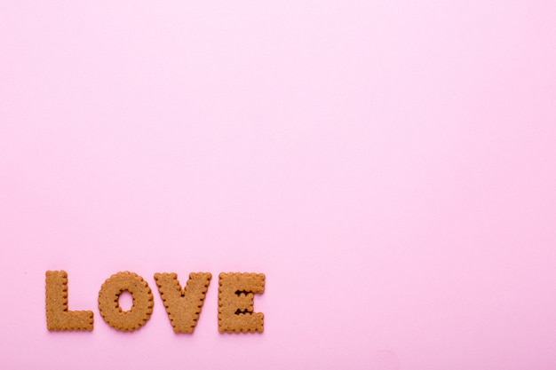 Letters tasty cookies love on pink