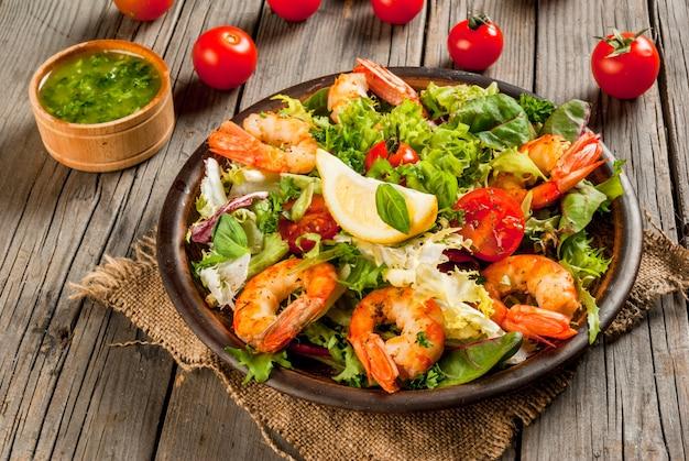 Lettuce salad with grilled shrimps prawns