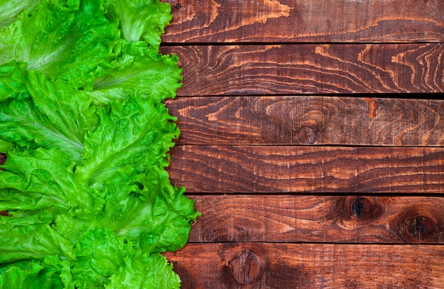Lettuce on wooden table, top view