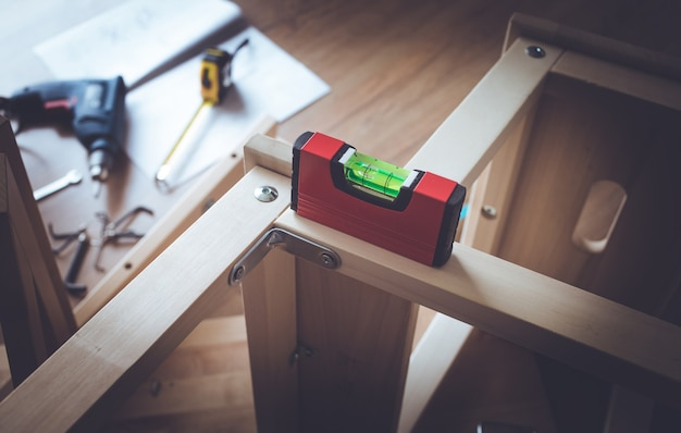 Levels tool on wooden furniture in workplace.craftsman diy concepts ideas