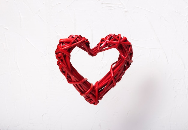 Levitation wicker red heart on white background concept valentine's day, free open heart.