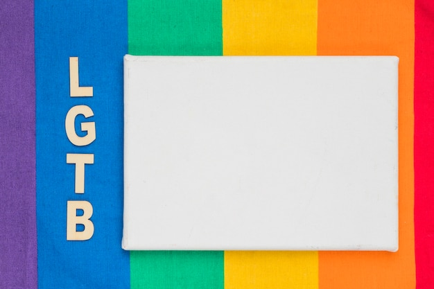 Lgbt abbreviation and white paper sheet on colorful background