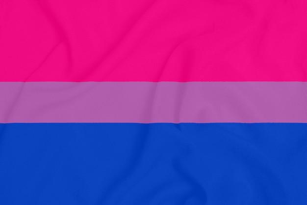 Lgbt bisexual pride community flag on a textured fabric. pride symbol