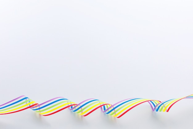 Lgbt community pride rainbow ribbon awareness on white background.