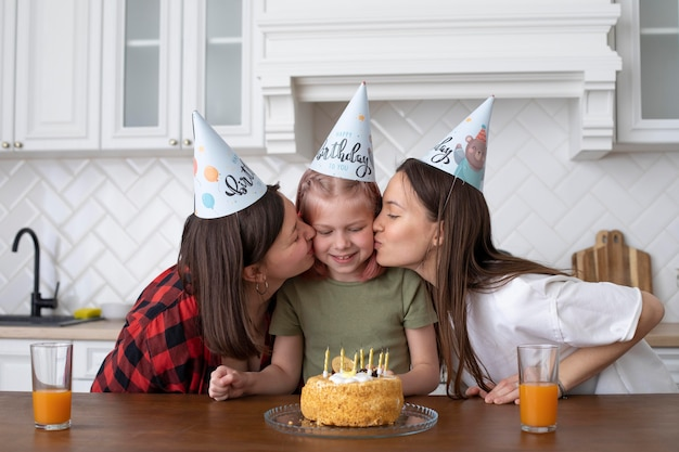 Lgbt couple spending time together with their daughter on her birthday