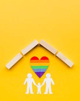 Lgbt family concept on yellow background  with copy space
