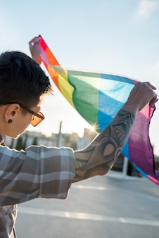 Lgbt flag in hands of person