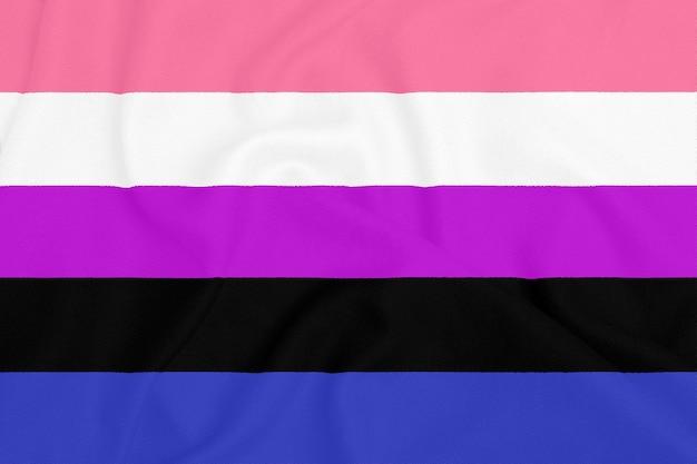 Lgbt genderfluid pride community flag on a textured fabric. pride symbol