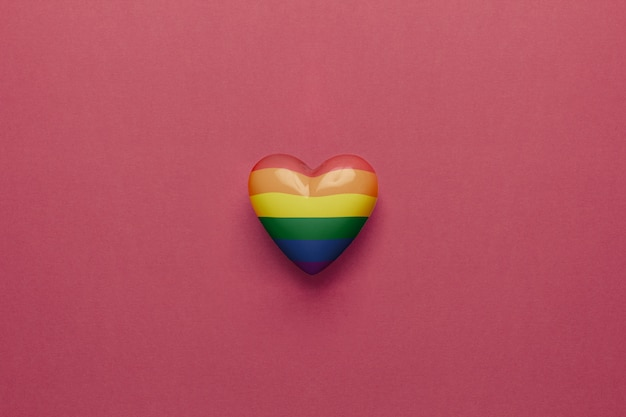 Lgbt heart on a red background