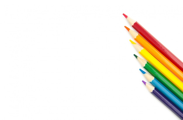 Lgbt pride rainbow flag made of six colored pencils on white