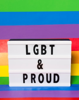 Lgbt and proud concept with rainbow background