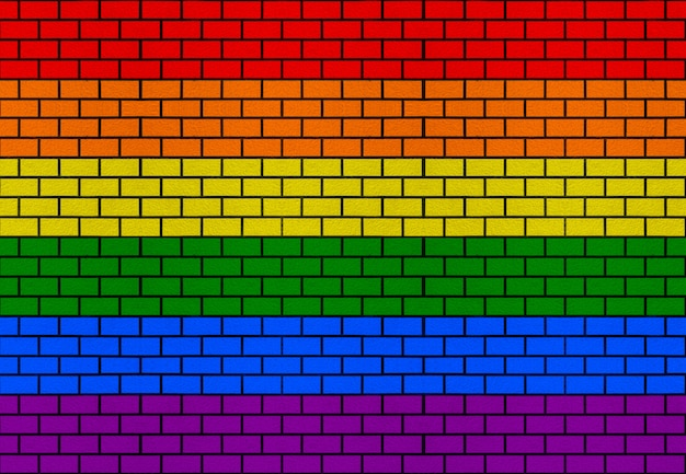 Lgbt rainbow flag color brick block stack residential wall texture design background.