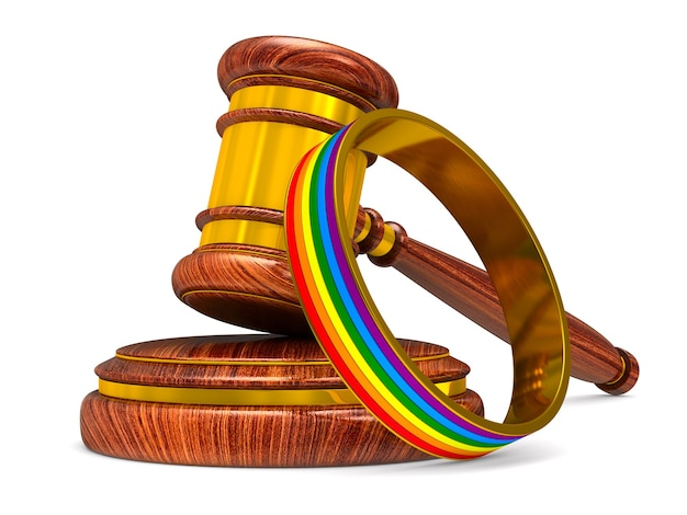 Lgbt ring and wooden gavel on white