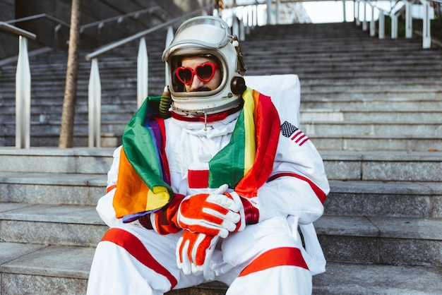 Lgbt spaceman in a futuristic station man with space suit walking in an urban area