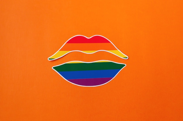 The lgbt symbol made of paper on an orange background