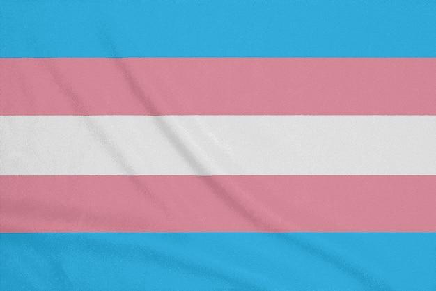 Lgbt transgender community flag on a textured fabric. pride symbol
