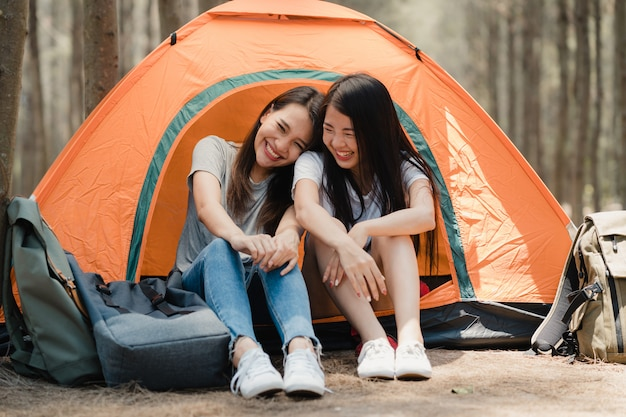 Lgbtq lesbian women couple camping or picnic together in forest