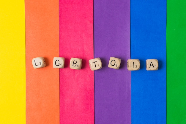 Lgbtqia word of cubes and gay flag