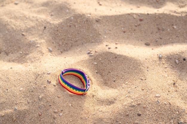 Lgtbiaq + bracelet on the beach sand