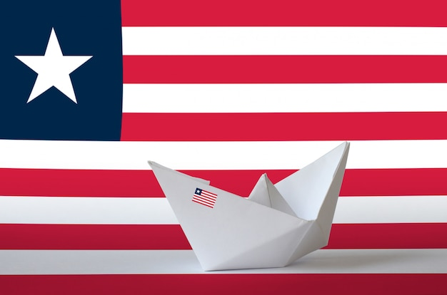 Liberia flag depicted on paper origami ship closeup. handmade arts concept