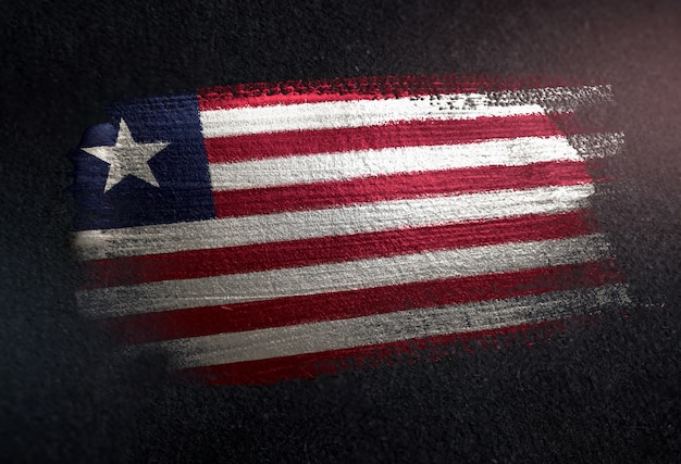Liberia flag made of metallic brush paint on grunge dark wall