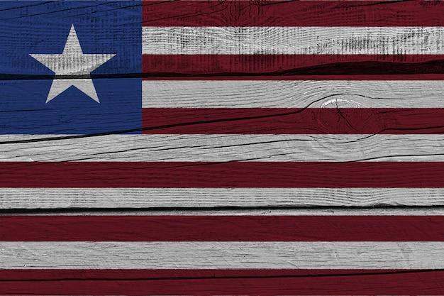 Liberia flag painted on old wood plank