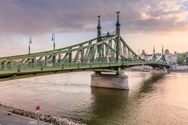 Liberty bridge in sunset in budapest.