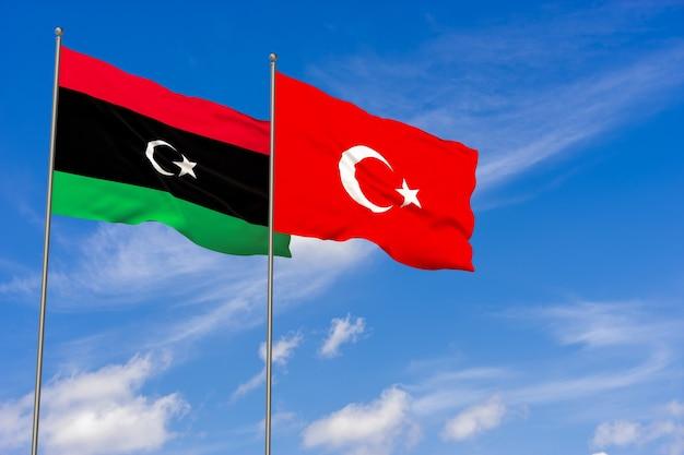 푸른 하늘 배경 위에 리비아와 터키 플래그입니다. 3d 일러스트레이션