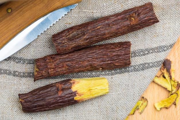 Licorice root peeled with razor.