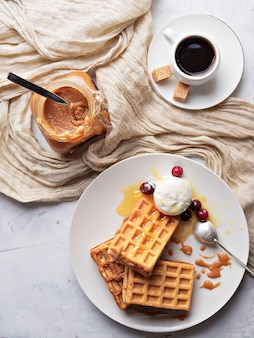 Liege (belgian) waffles with caramel, berries and ice cream