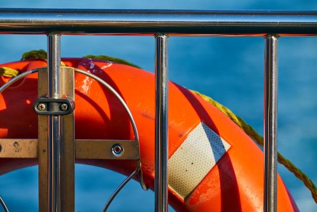 Life buoy and blue sea