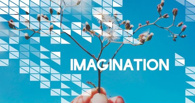 La motivazione della vita ispira le vibrazioni positive citazione sul fiore e sullo sfondo del cielo blu