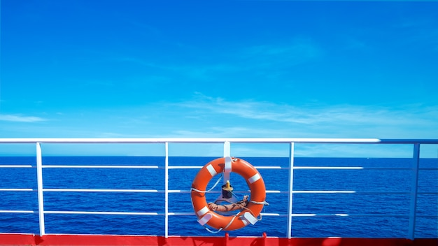 Life preserver on deck on sea background