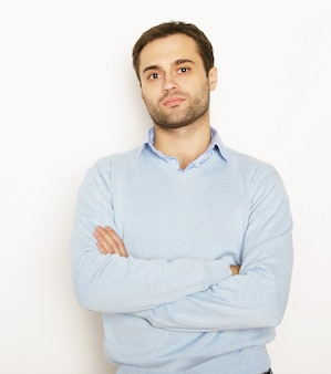 Life style and people concept: happy young man in blue shirt. over white background.