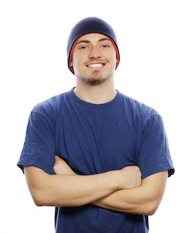 ライフスタイル、スポーツ、人々のコンセプト-青いtシャツと青い帽子の若いハンサムな男。