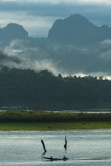 Life style with a boat in a large reservoir in sangklaburi kanchanaburi, thailand