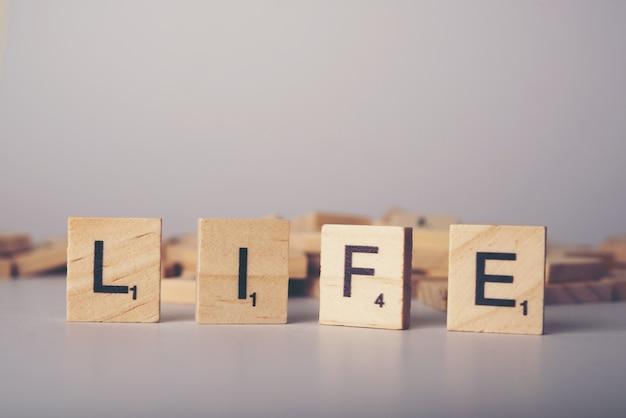 Life wooden tile font concept