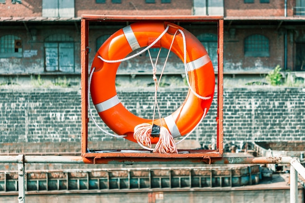 Lifebuoy, against a brick wall.